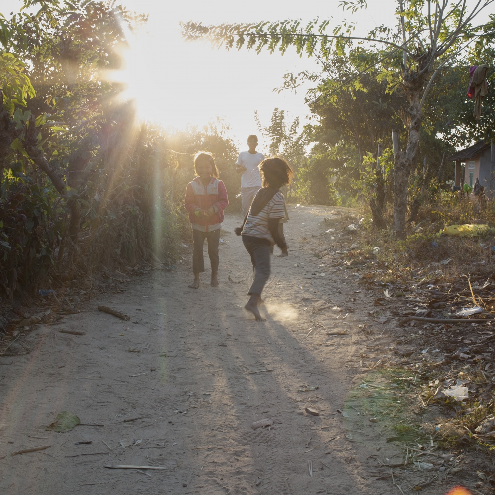 Kids playing in the sunset.