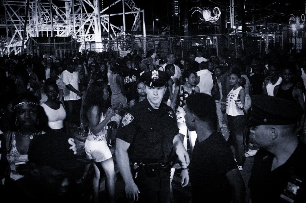 Photography image - From my essay Too Many Black People in One Place, NYC cops keep a close watch on young people trying to enjoy Fourth of July at the beach.