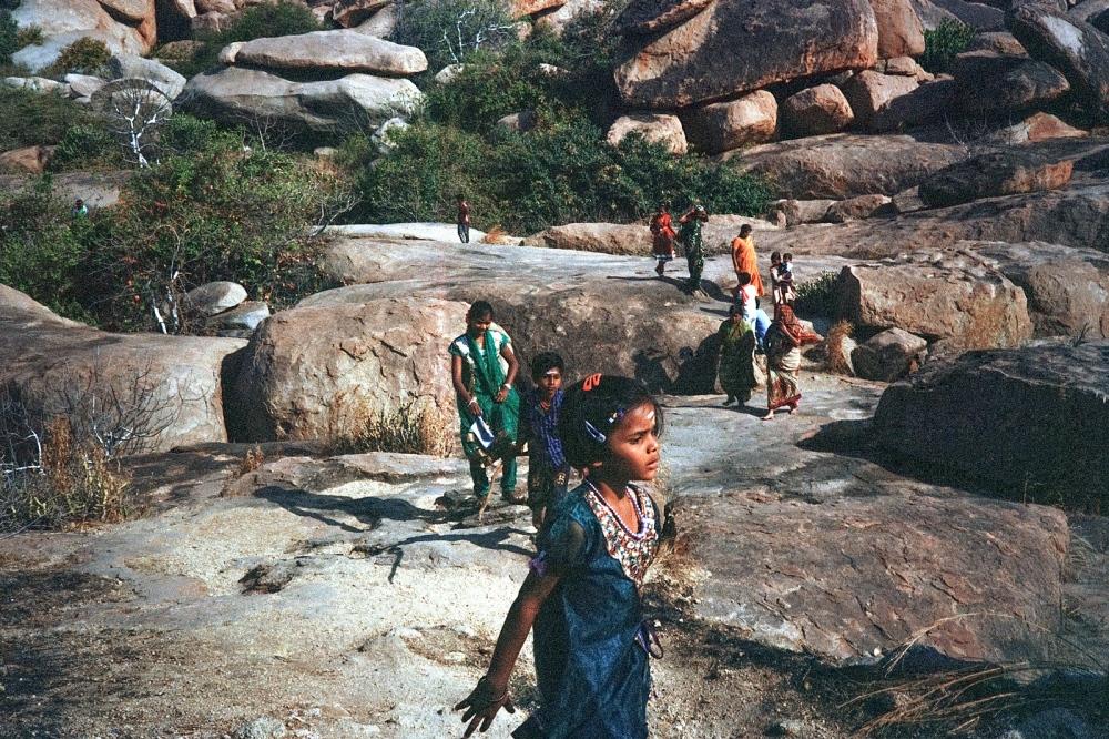 A family walk through the boulders, Anegundi.