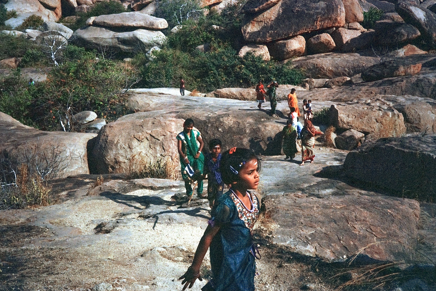 A family walk through the boulders, Anegundi.