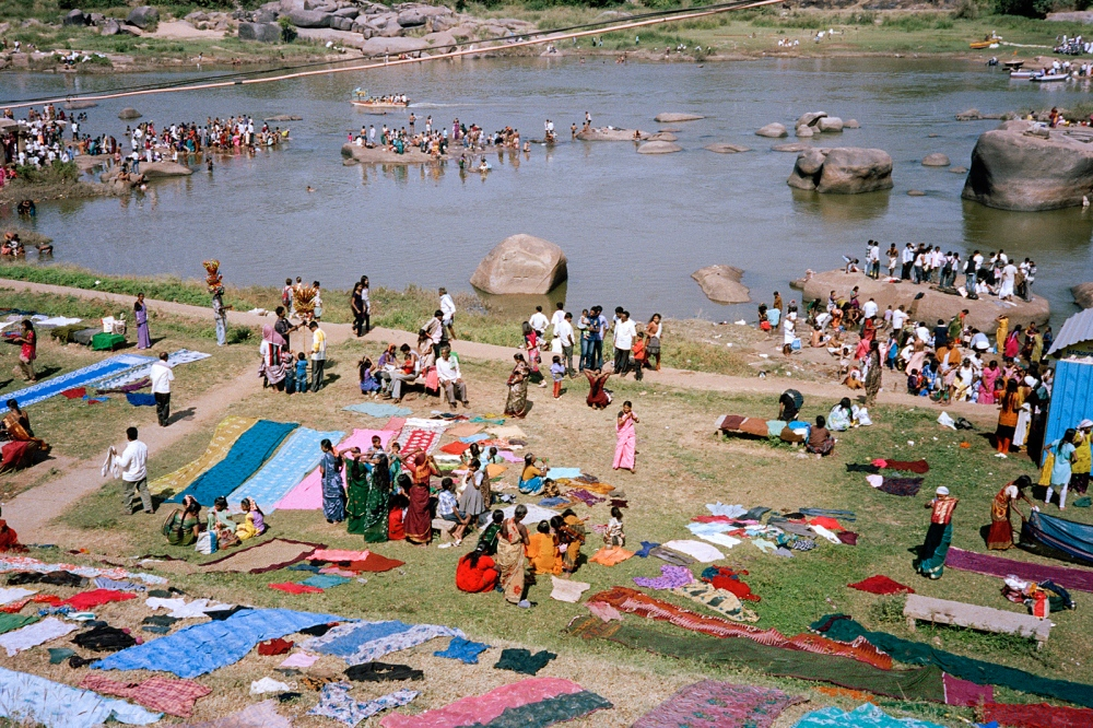 The day after the famous Hampi Festival. Families swim and wash in the Tungabhandra River.