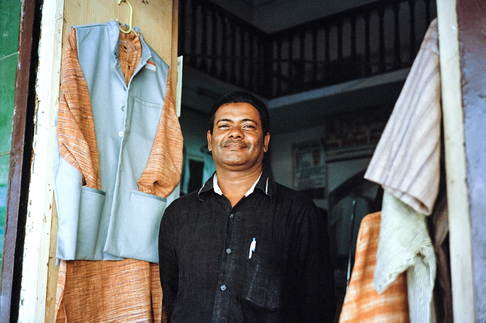 Tailor, Hampi Bazaar. One of the few remaining shops in the bazaar since the decision to evict the businesses in a hope to restore and protect the bazaar and surrounding area as a world heritage site.