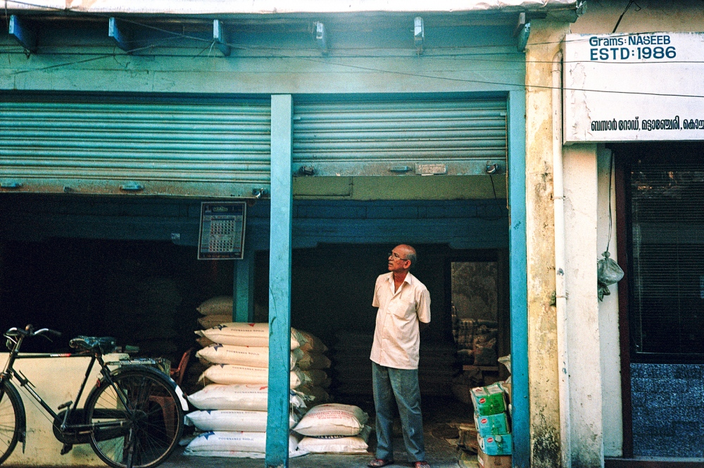 Man waiting outside a 'Go- Down' (the Indian term for warehouse).