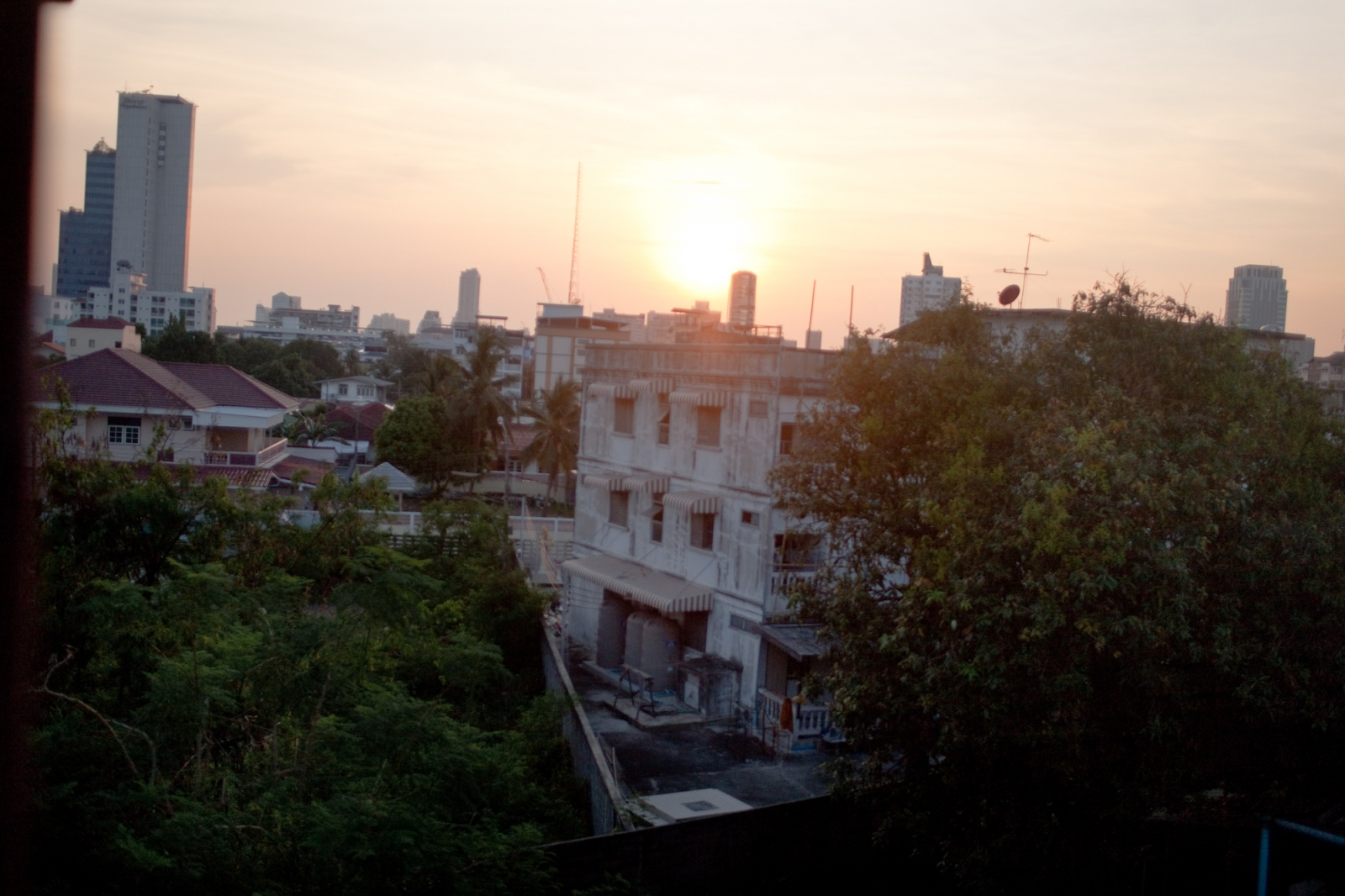 A view of the city of Bangkok from a low income building that houses many different people who are seeking asylum from their country. The rooms have very little air flow which makes it extremely hot all day. Apr. 2015