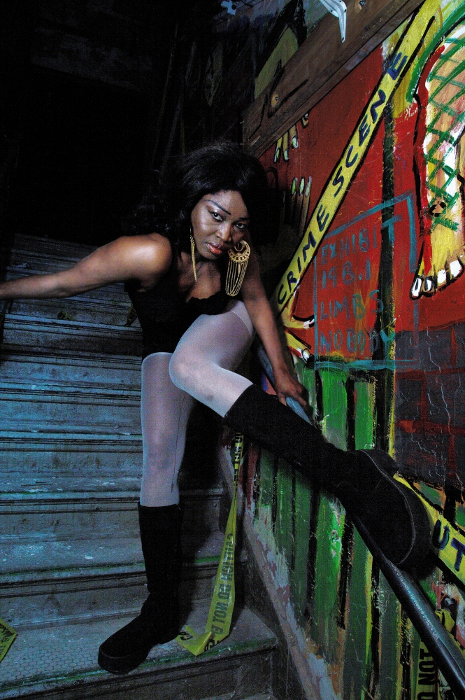 Princess Pat Muko from Nigeria, seen here in the back stairwell at Coney Island USA. Muko is a regular performer in Neo-Burlesque and of traditional sideshow acts such as the Electric Chair and Straightjacket Escape.