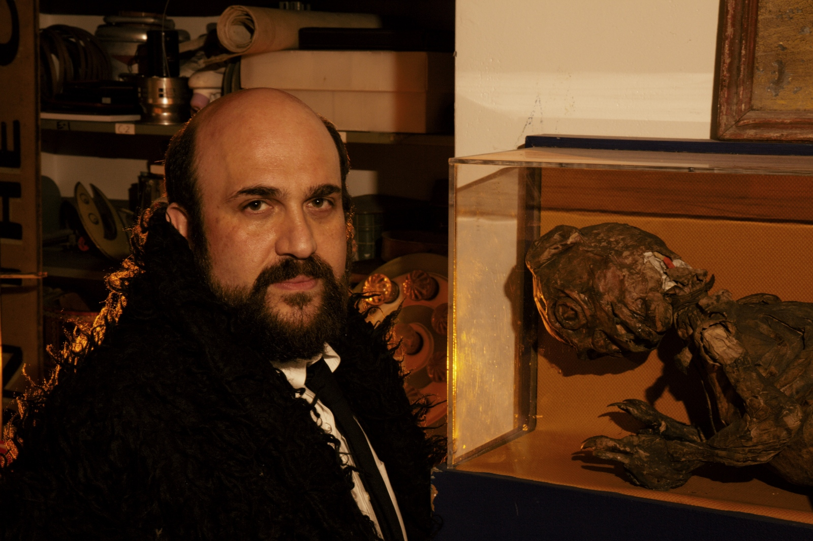 "PHD candidate Philip Kadish poses next to a Fiji Mermaid in the Coney Island Museum before his lecture on ""Pinhead Races and the White Man's Burden: Racial Science and the Politics of P.T. Barnum's ""What Is It?"" A Fiji mermaid is the torso and head of a young monkey sewn to the back half of a fish and covered in papier-mâché. It was a common feature of sideshows for decades."
