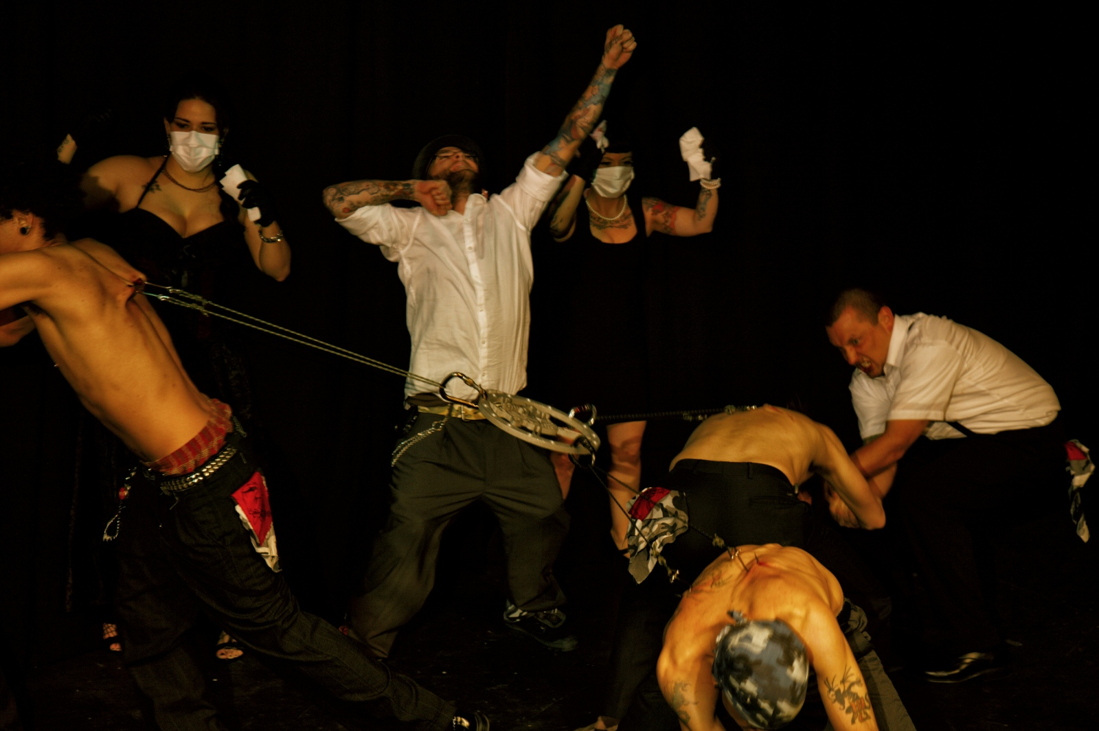 Performance by members of theCabaret of Flesh in which they attach hooks to their backs and run in different directions.