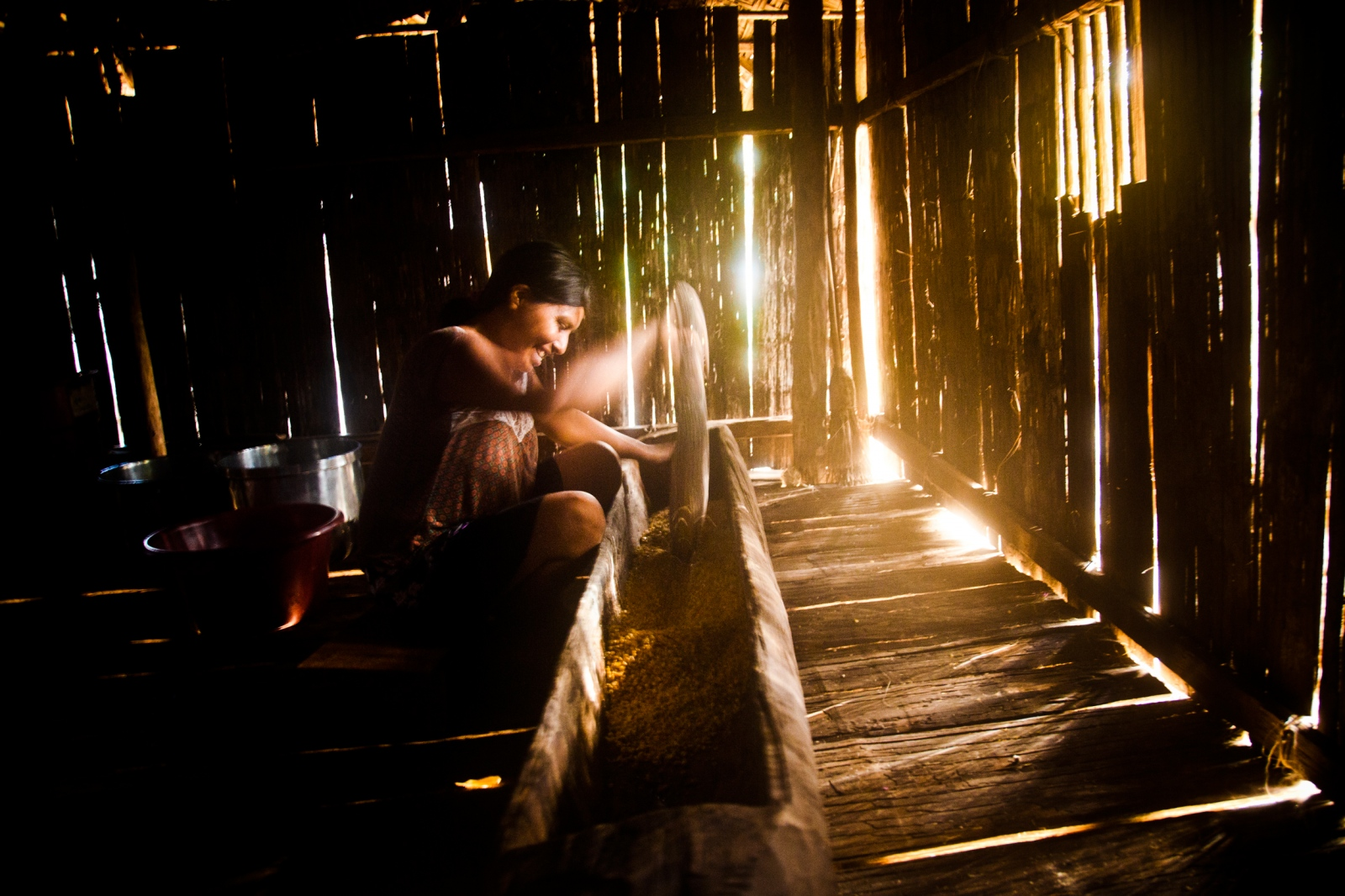 A Matsés woman is seen making a traditional drink that takes around 8 hours to make.