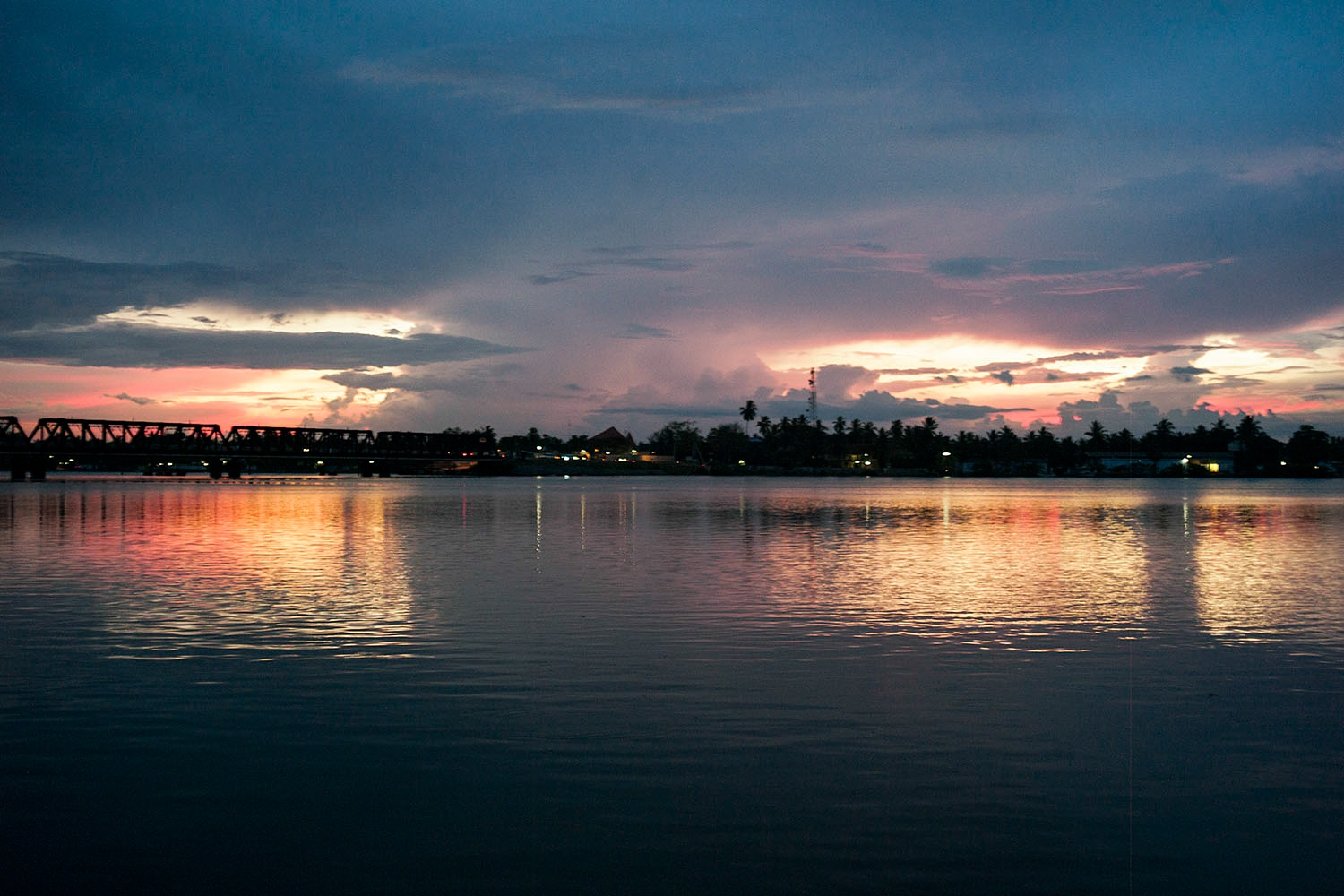 A thunderstorm approaches over the Batticaloa lagoon and Kallady Bridge. These lagoons were once fired across during the war, the Sri Lankan military from the town and the LTTE in the villages.