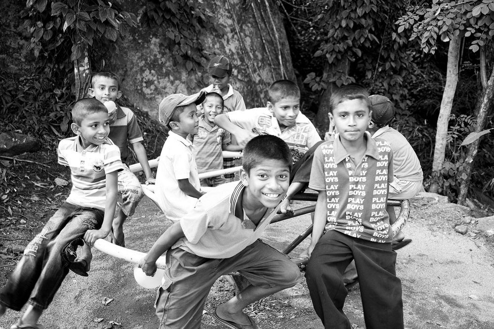 Children take a break from lessons at a school situated high up in the Knuckles Mountain Range.
