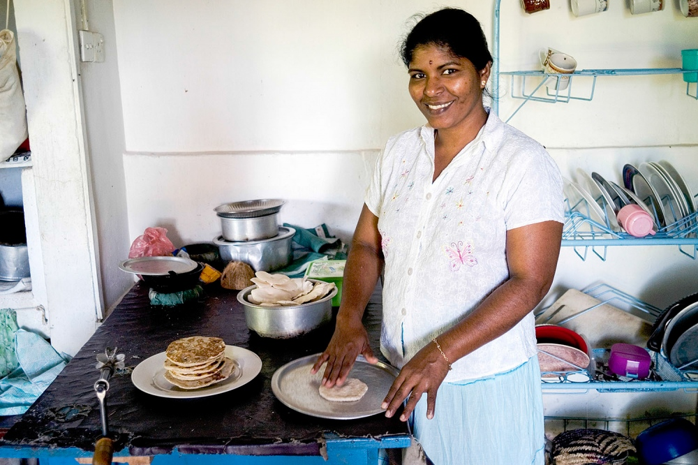 A volunteer makes roti in a community centre kitchen high up in The Knuckles Mountains.