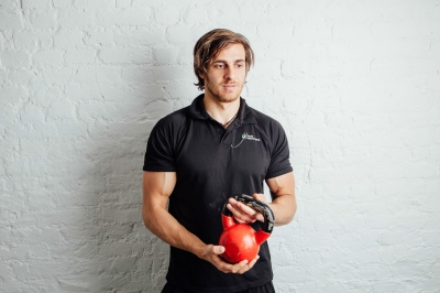 Peter, a personal trainer. Press shot.