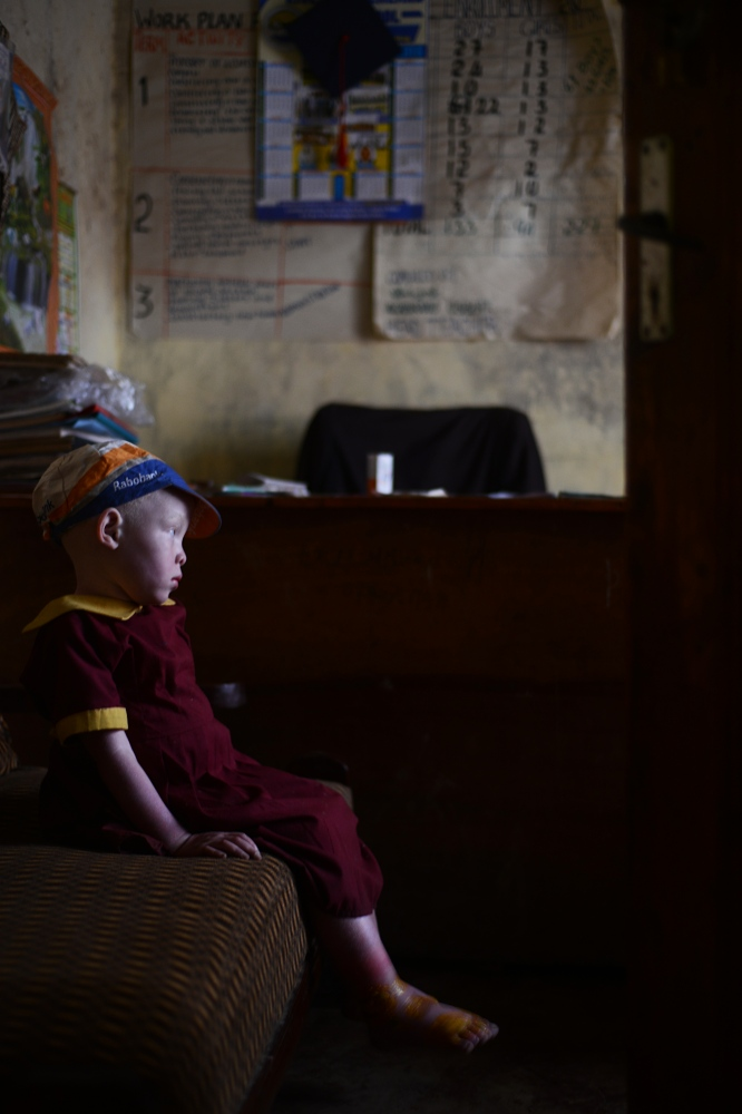After retuning from the hospital, Karibo waits in the headmaster's office at school outside Kabale.