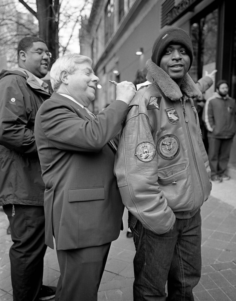 Borough President Marty Markowitz signs autograph during grand opening of Shake Shack on Fulton Street Mall, December 2011