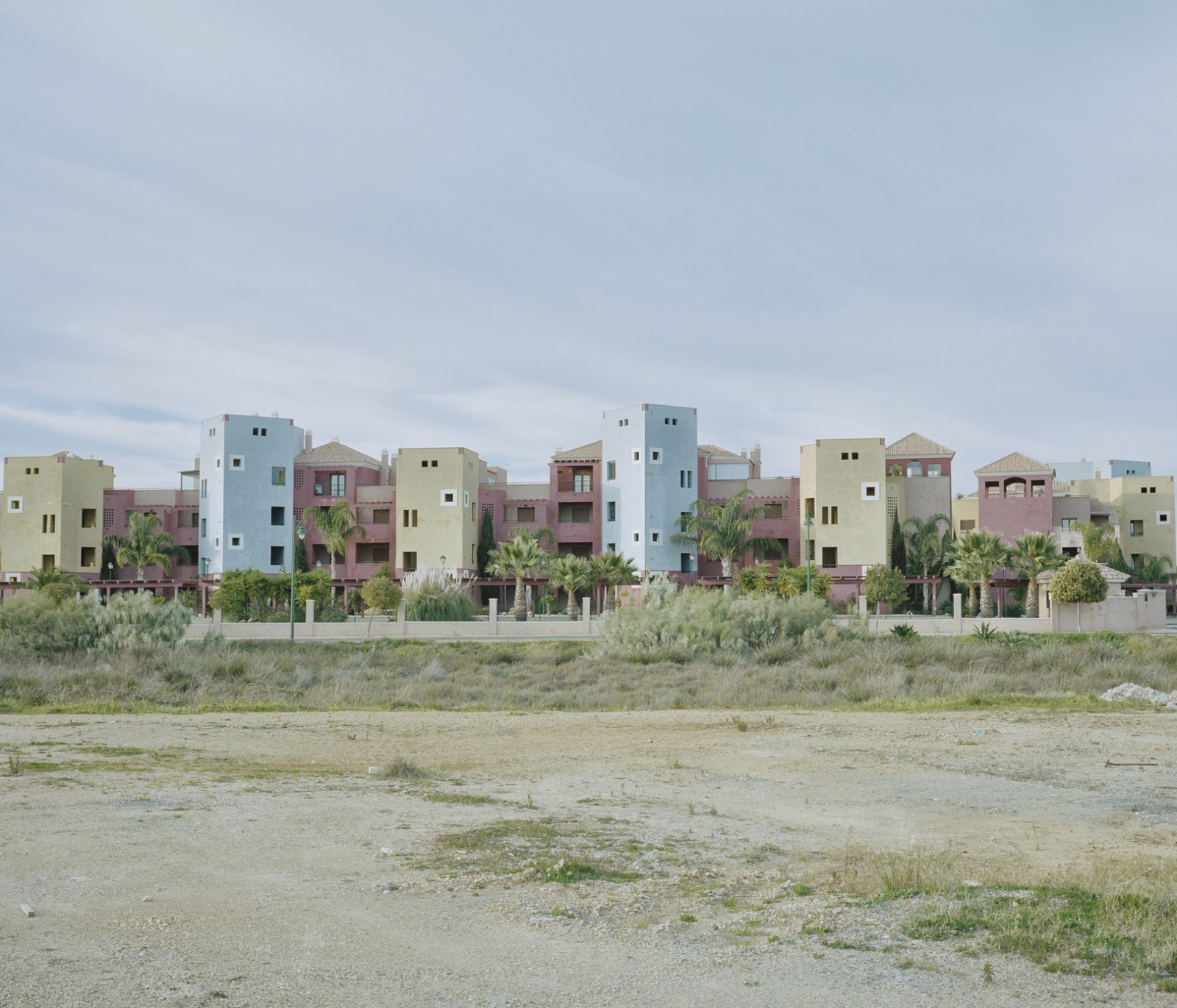 Spain, Ayamonte. Buildings on a beach of Ayamonte. Before the economical crisis Portugal and Spain strongly invest in civil construction, today several apartments built are empty while several buildings were left incomplete due to the lack of funding.