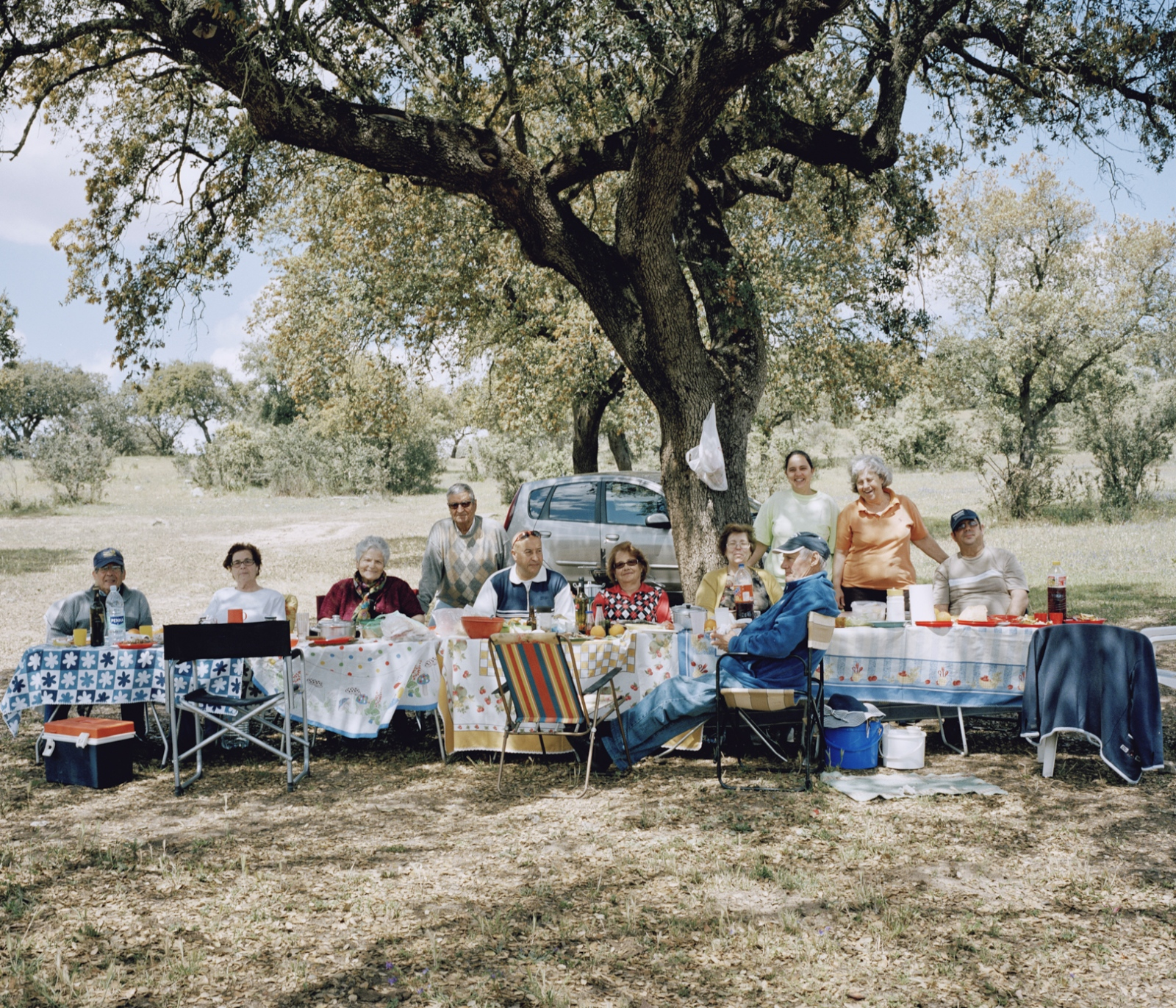Portugal, Elvas. A group of neighbors have a sunday picnic near the river that divides Portugal and Spain.