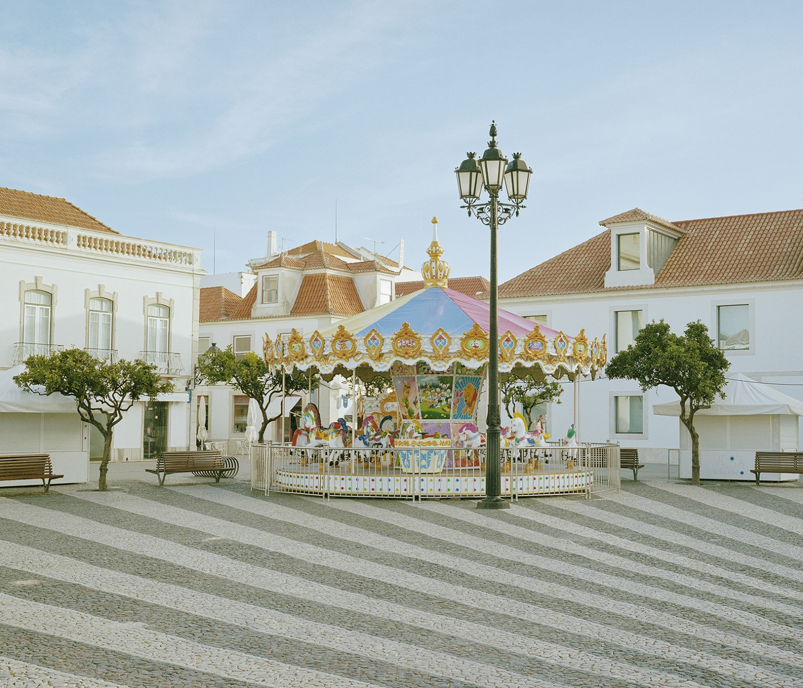 Portugal, Vila Real de Santo Antonio. A carosel in an empty square of the city. During the economical crisis Portugal suffered a decrease of the national tourits.