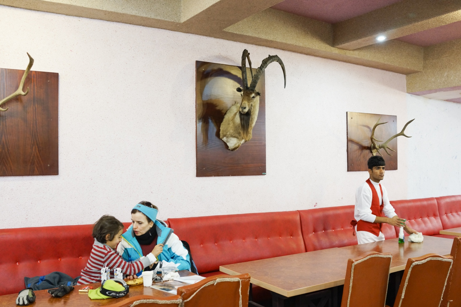 Clients and a worker are photographed in the restaurant of a chalet in Tochal, Alborz Mountains, North of Tehran. December 29, 2014