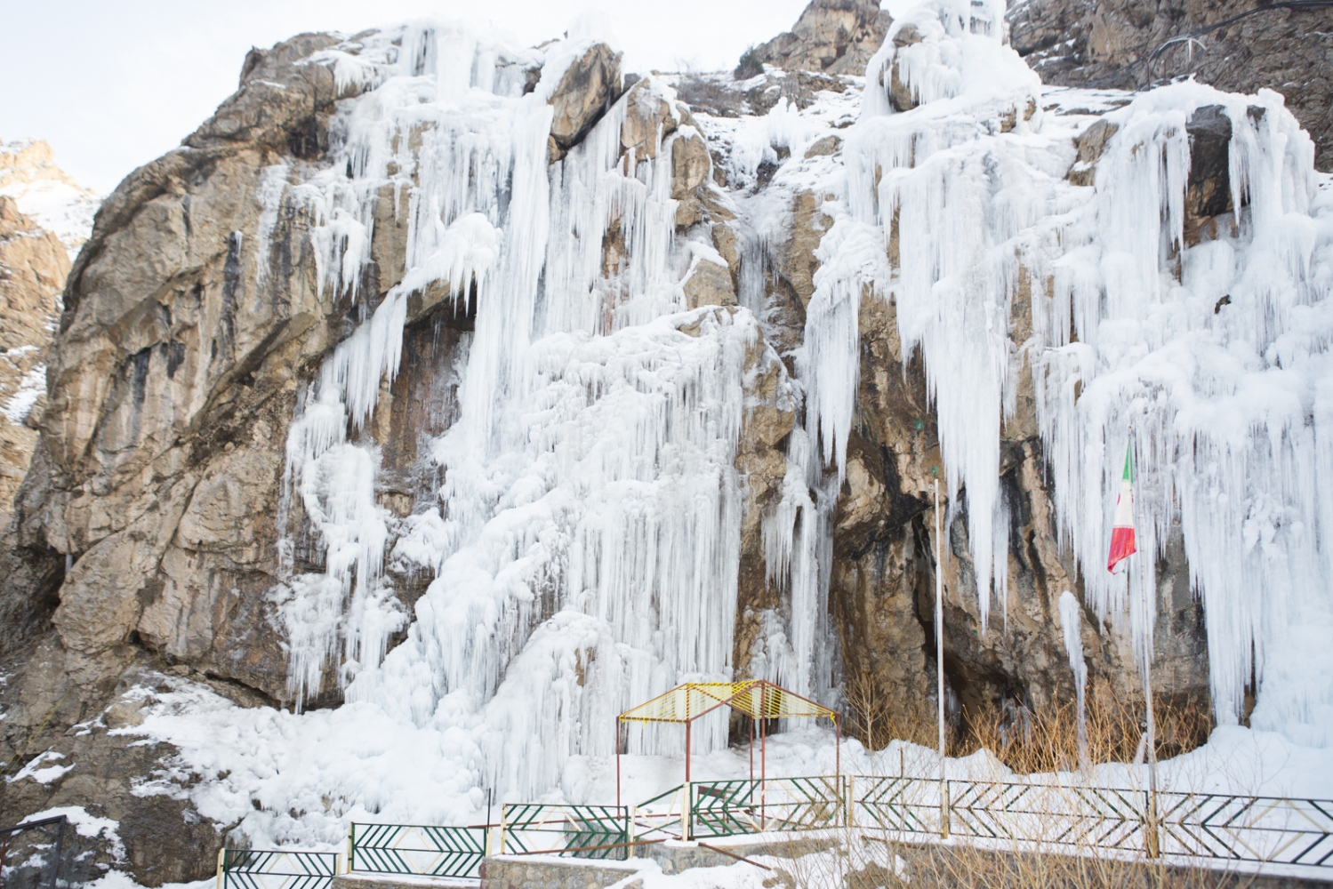 The Hamaloon Ice Wall, formed by the leaking of water brought to the shady Hamaloon Valley from a nearby spring, is a popular destination for rock climbers. Nearby Darbandsar, Alborz Mountains, North of Tehran. January 03, 2015