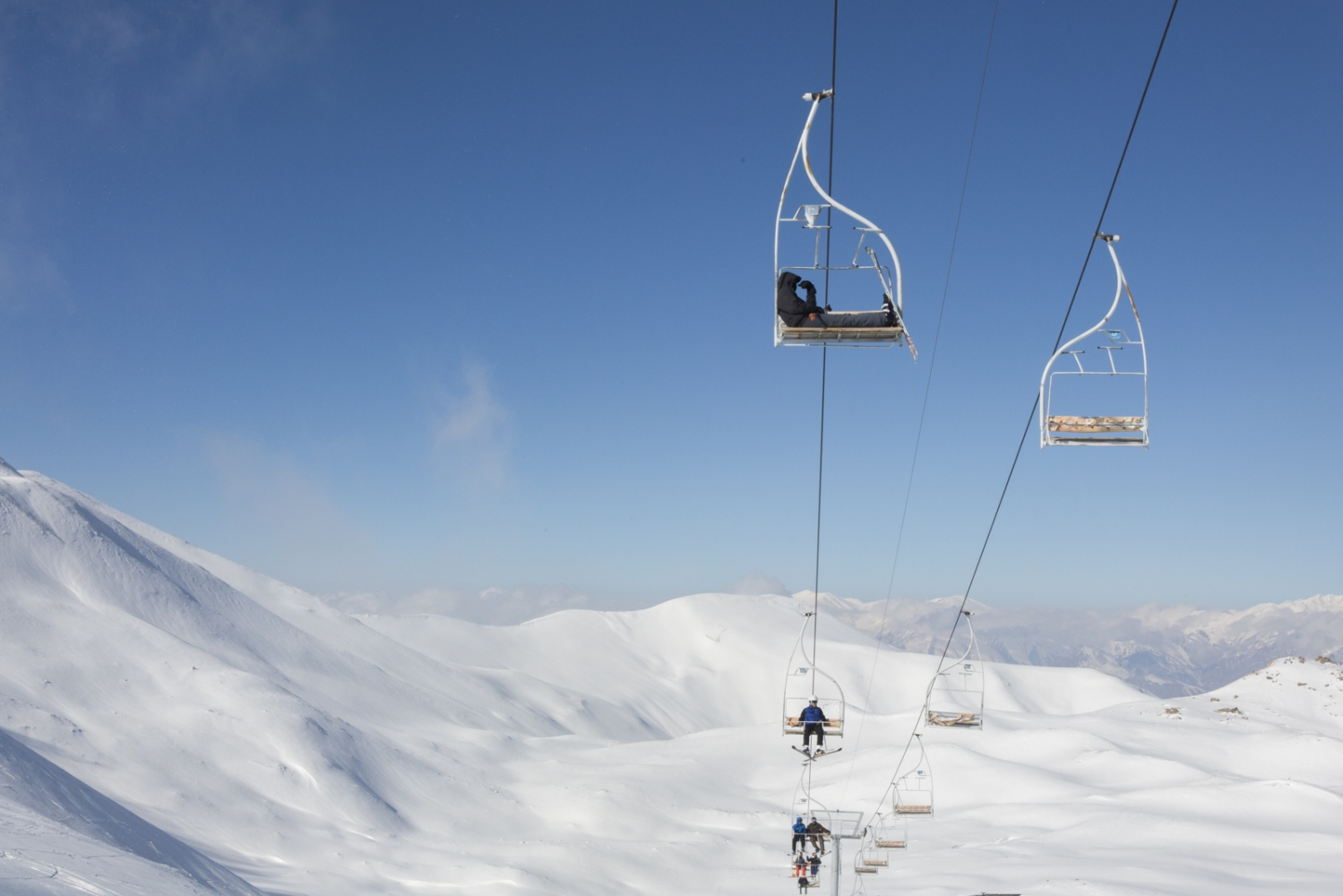 Skiers go up Tochal's slope on a chair lift. Alborz Mountains, North of Tehran. December 29, 2014