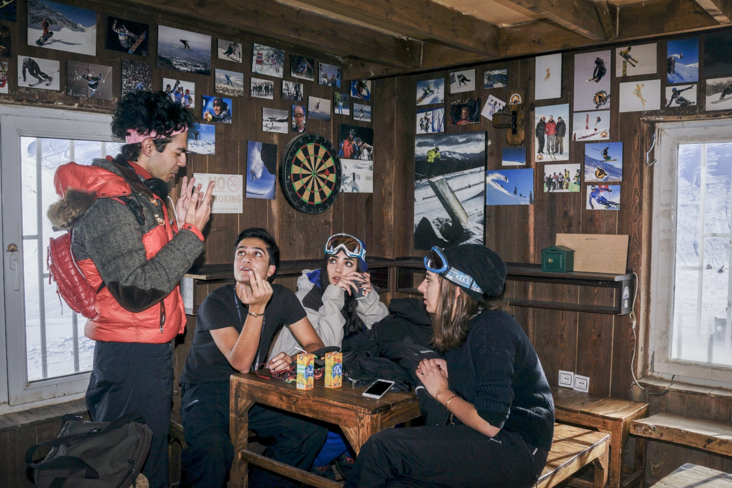 Young Iranian snowboarders relax at a chalet in the resort of Dizin, Alborz Mountains, North of Tehran. December 31, 2014
