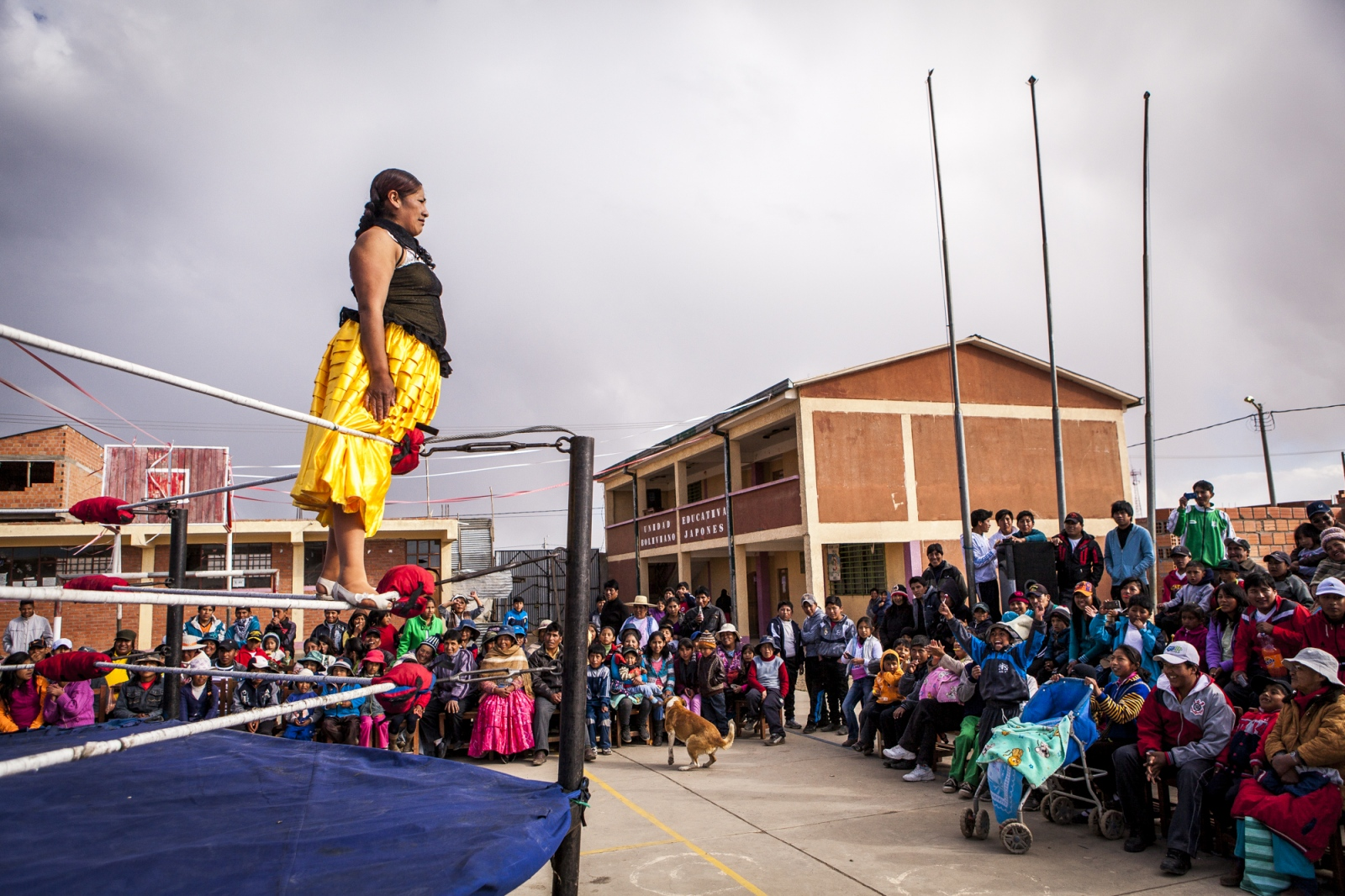 Silvina La Poderosa, 37, looks to the public on top of the ropes during an exhibition fight in Senkata. They sometimes do exhibition fights in different locations of Bolivia to promote and attract younger people to the sport.