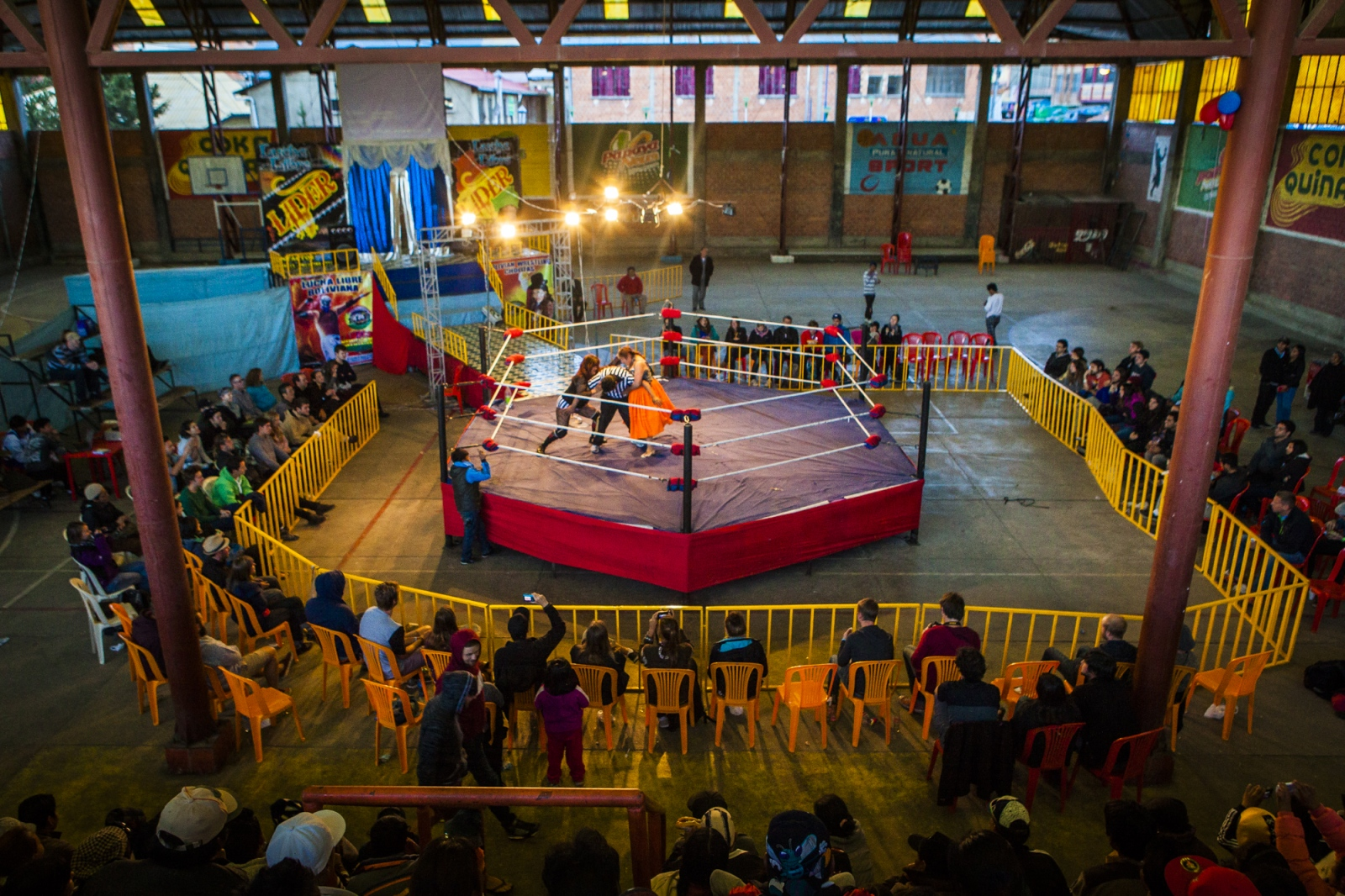 The ring of the 12th October Sports Complex, where cholitas fights happens every Sunday. The fights attract many Bolivians and tourists. Tourists pay five times higher prices to sit in the front rows on plastic chairs, while the locals sit on the cement stands.