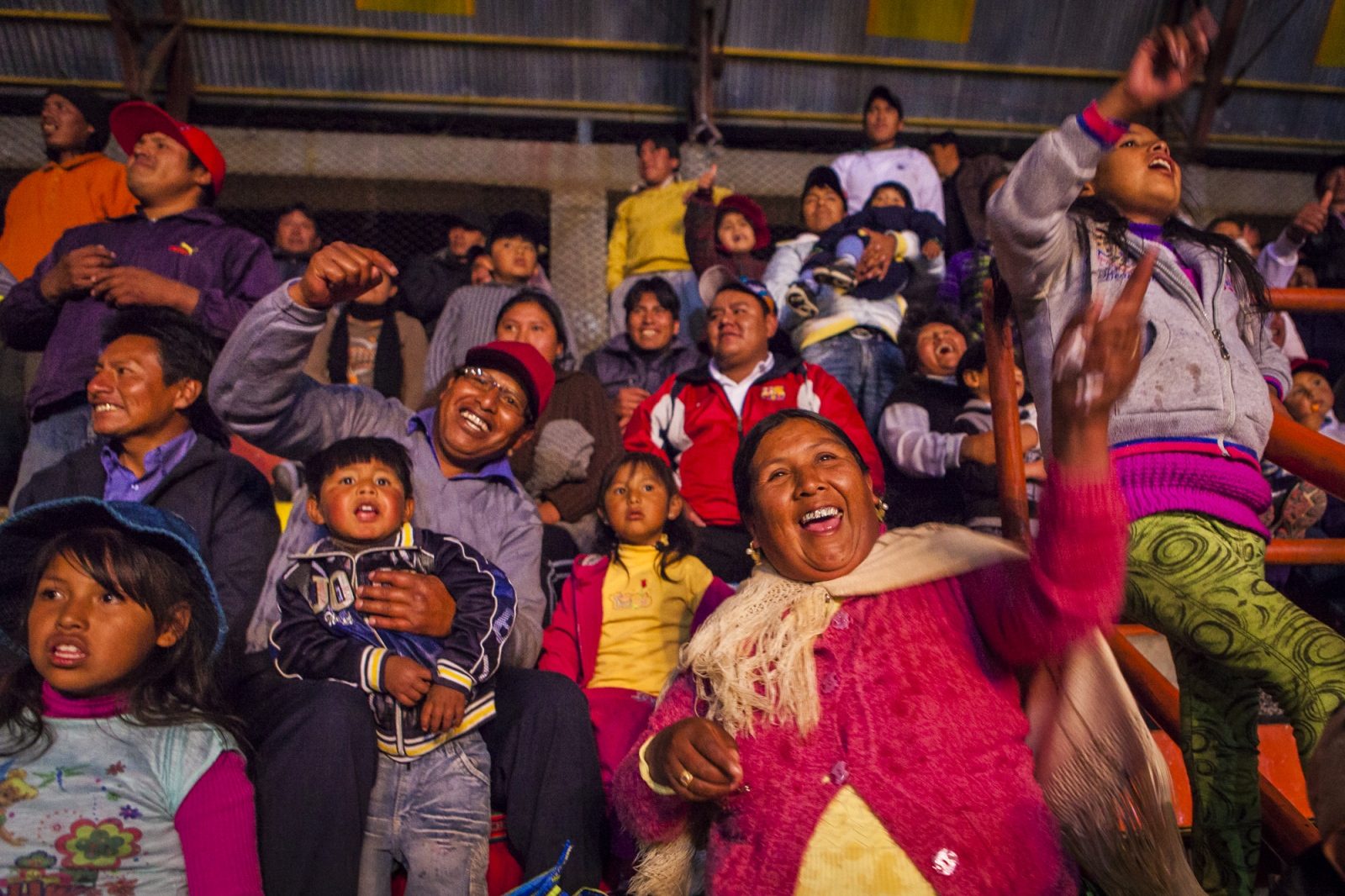 The Bolivian public cheers the cholitas during a fight in the 12th October Complex in the city of El Alto. To many people in town going to see the fights of the Cholitas is their favourite Sunday past time.