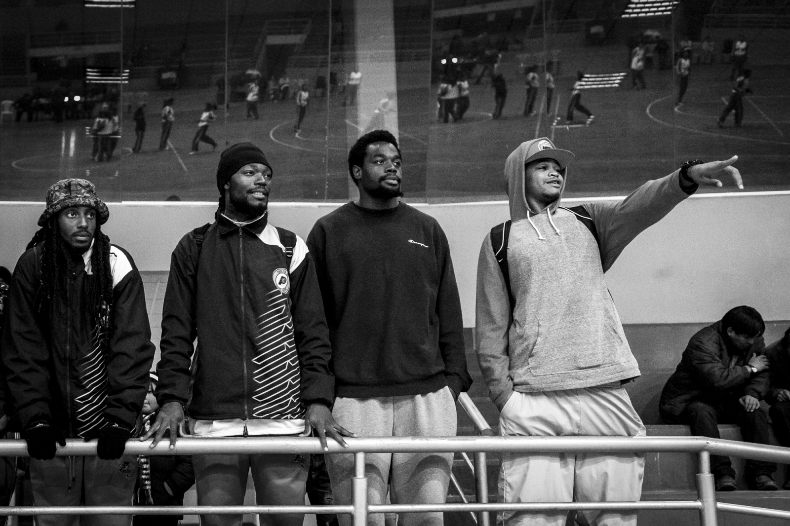 Domonick Steverson, Travis Dupree, DeQuan Massey and Rory Miller watch a female players before a game. Pueblito Nets will play after that against the Nusevic team, which add to their squad also three Americans.