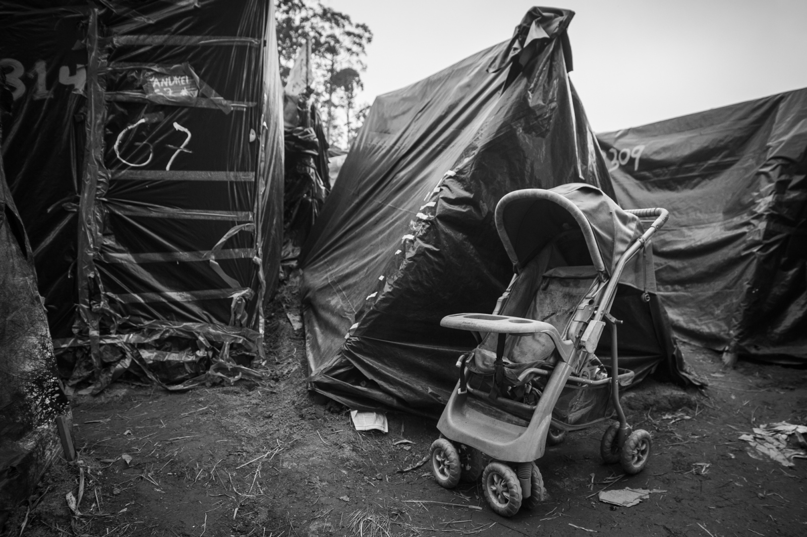 A baby kart outside one of the tents where lives a family in Copa do Povo (People's Cup) Camp in Itaquera, São Paulo. The Copa do Povo Camp, is just a few miles from the Arena Corinthians and has 5,000 homeless workers and their families occupied area of fifteen acres. They are homeless after rents skyrocketed because of the World Cup.