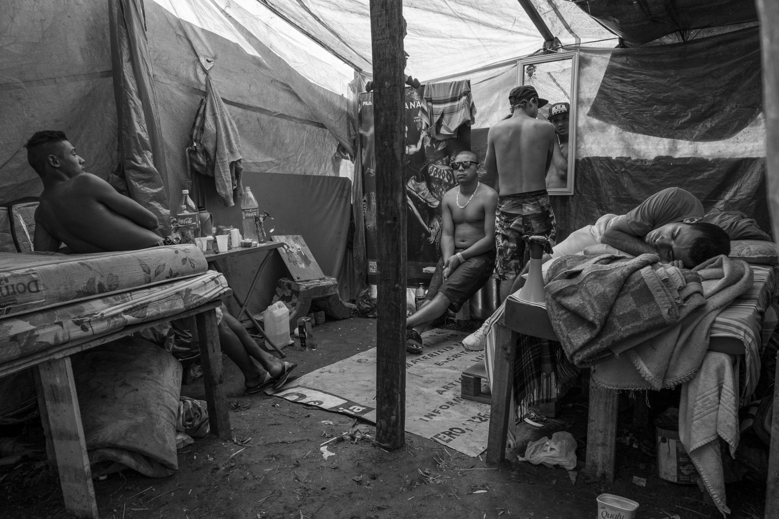 Teenagers hangout in one of the shelters in Copa do Povo (People's Cup) Camp in Itaquera, São Paulo. The Copa do Povo Camp, is just a few miles from the Arena Corinthians and has 5,000 homeless workers and their families occupied area of fifteen acres. They are homeless after rents skyrocketed because of the World Cup.
