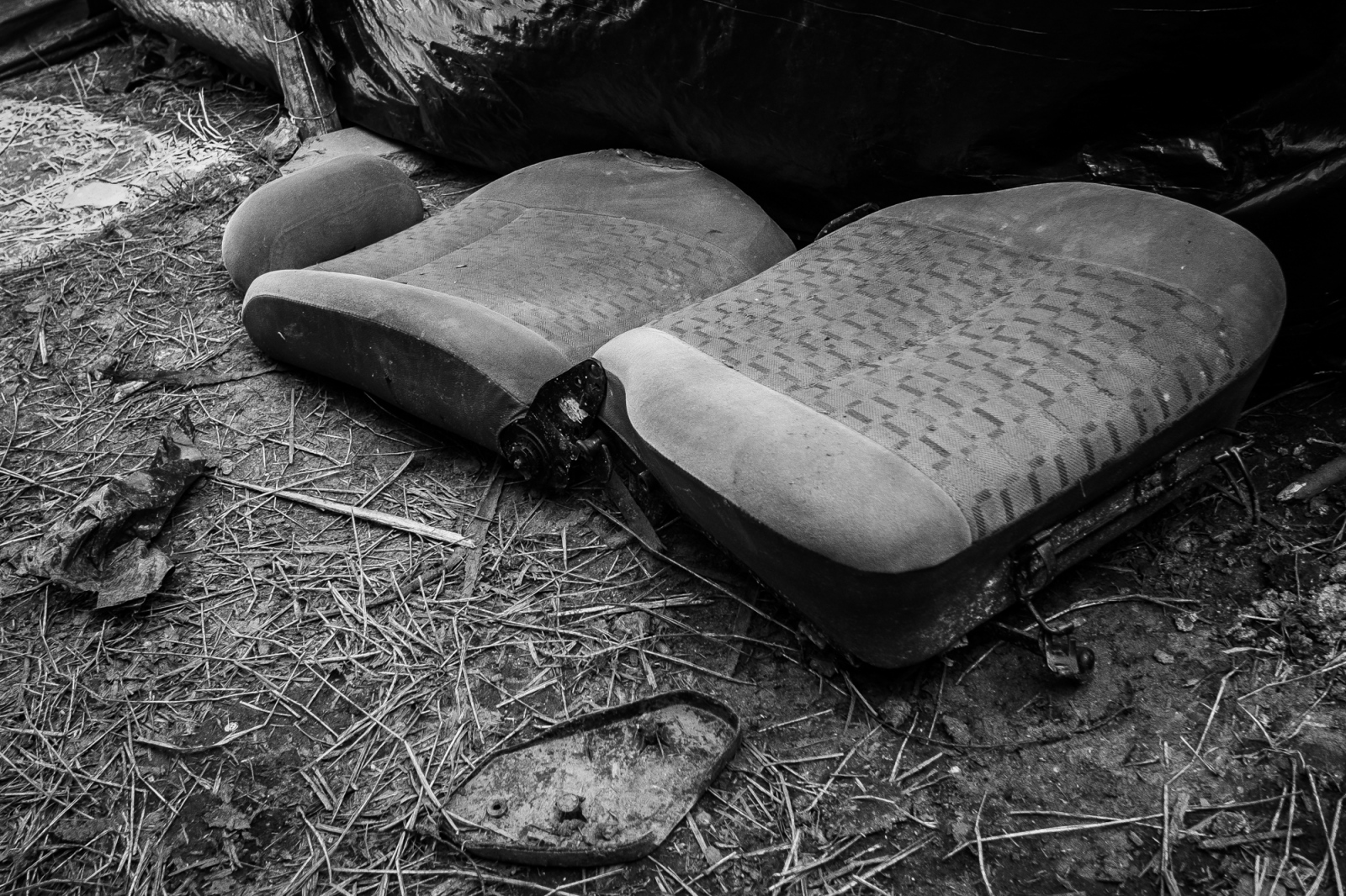 A car seat that serves as a bed inside one of the shelters in the Copa do Povo (People's Cup) Camp in Itaquera, São Paulo. The Copa do Povo Camp, is just a few miles from the Arena Corinthians and has 5,000 homeless workers and their families occupied area of fifteen acres. They are homeless after rents skyrocketed because of the World Cup.