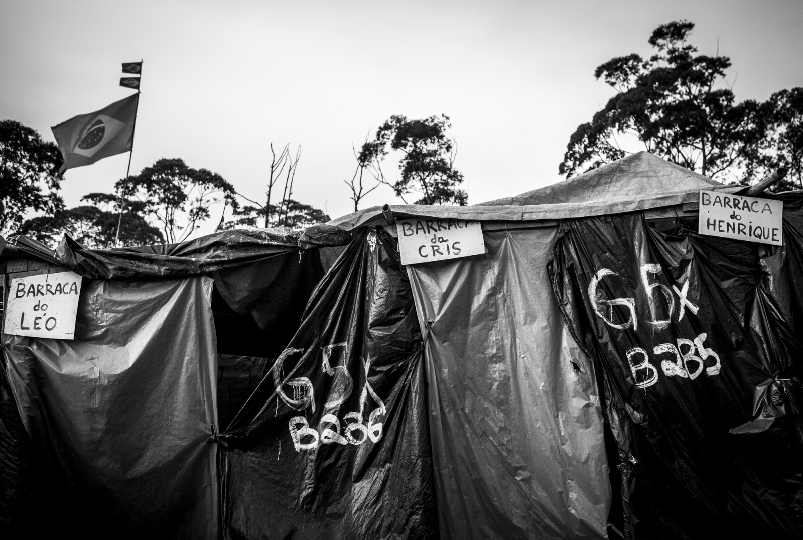 Tents in Copa do Povo (People's Cup) Camp in Itaquera, São Paulo, are organized by groups and have a respective number but people give the name of their family name to have a better felling of home. The Copa do Povo Camp, is just a few miles from the Arena Corinthians and has 5,000 homeless workers and their families occupied area of fifteen acres. They are homeless after rents skyrocketed because of the World Cup.