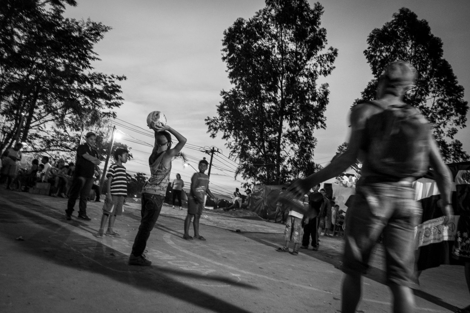 Children play football in the communal square  of the Copa do Povo (People's Cup) camp, Itauquera, São Paulo.The Copa do Povo Camp, is just a few miles from the Arena Corinthians and has 5,000 homeless workers and their families occupied area of fifteen acres. They are homeless after rents skyrocketed because of the World Cup.
