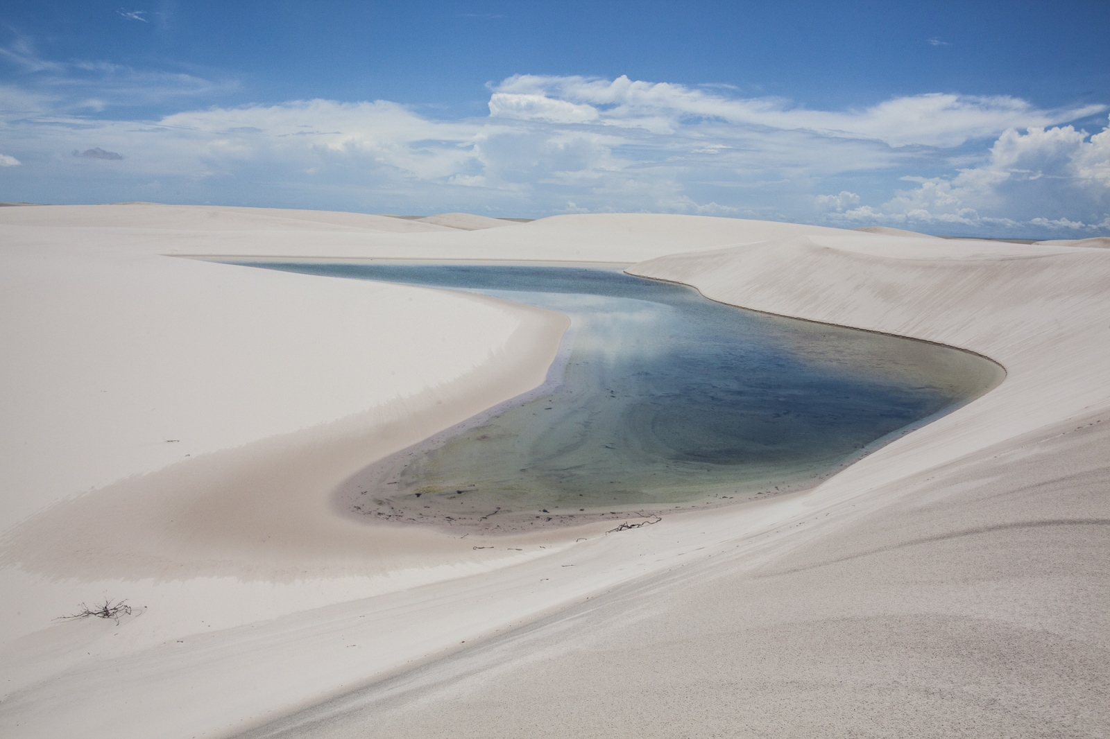 One of the Lençois do Maranhão lagoons during the Winter season. The sand filters the water from the rain and creates clear water lagoons. Lençois do Maranhão, a 155 thousand hectares National Park in the state of Maranhão, Brazil.