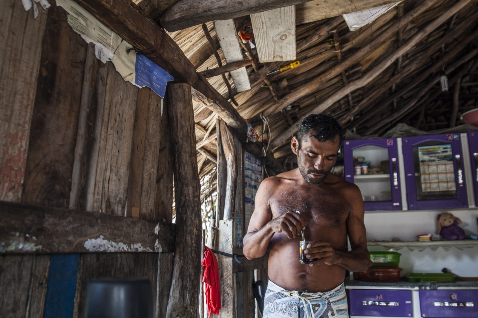 Aldemir Brito, 39, drinks coffee early in the morning in his house at Queimada dos Britos.