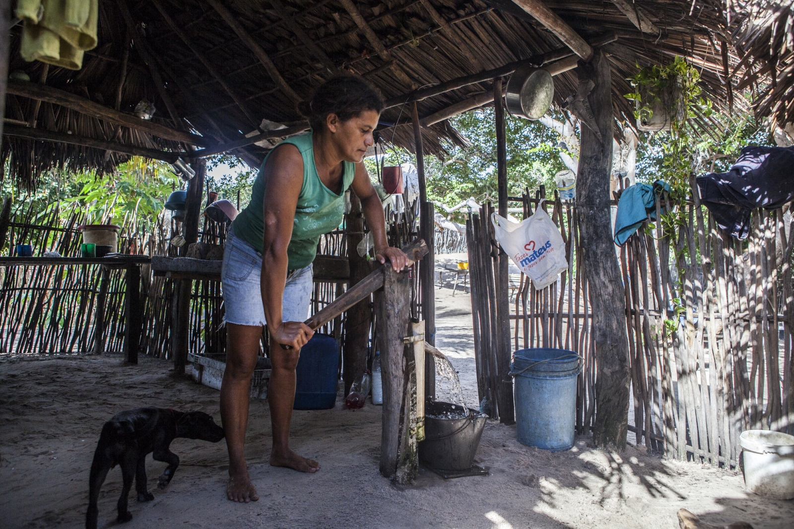 Aurideia Brito pumps water to prepare breakfast in her house in the Queimada dos Britos. Even during the harsh summers, they can pump water making it possible to live surrounded by desert.