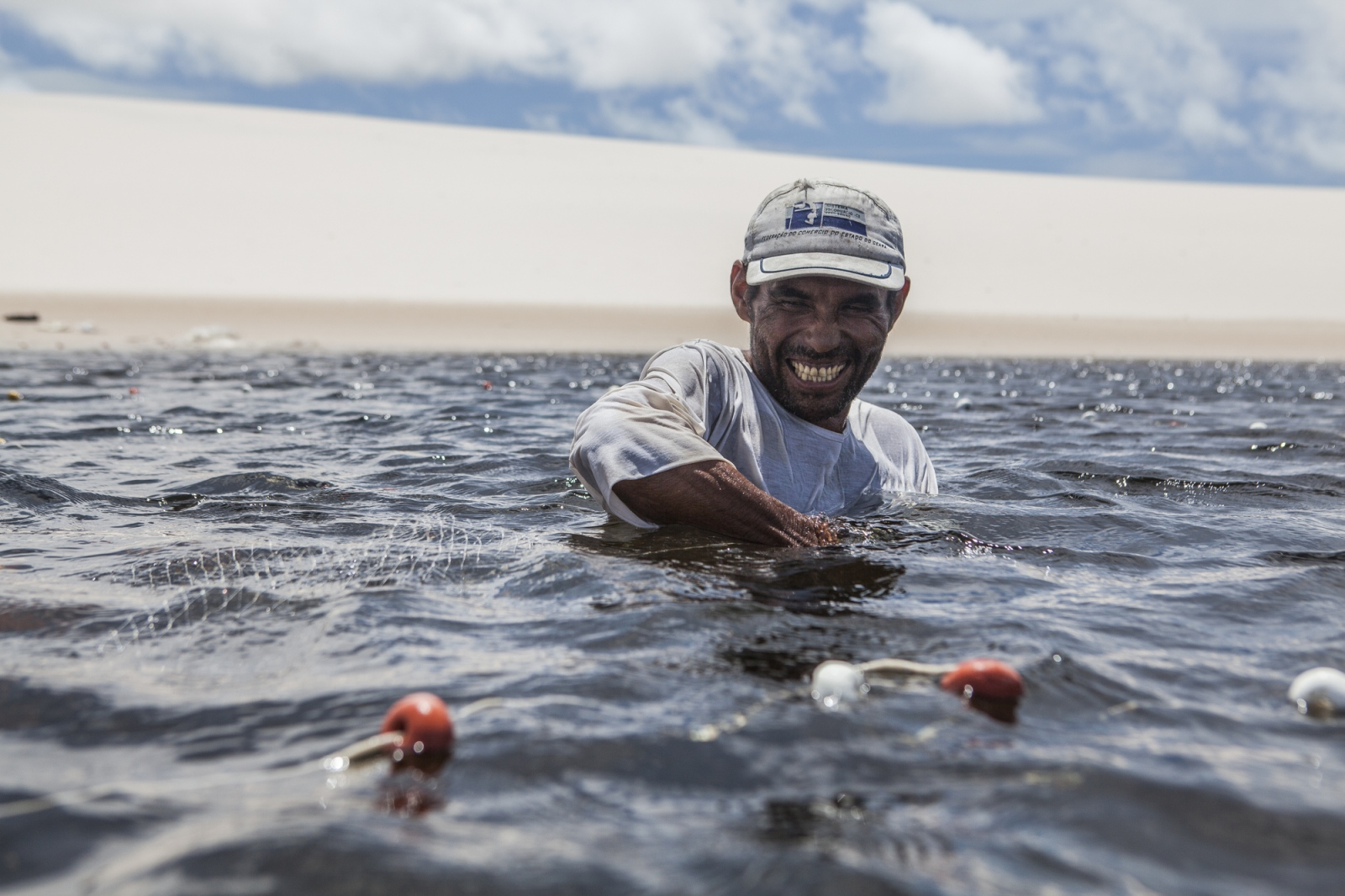 Aldemir Brito, 39, fishing in one of the lagoons close to his house in Queimada dos Britos. They live of fishing, which is two hours away. In the winter they breed fish on the lagoons, and cattle and goats that run free on the dunes. They have a small garden for farming but nothing major since they are afraid of the accelerating advance of the dunes that have already covered several houses.