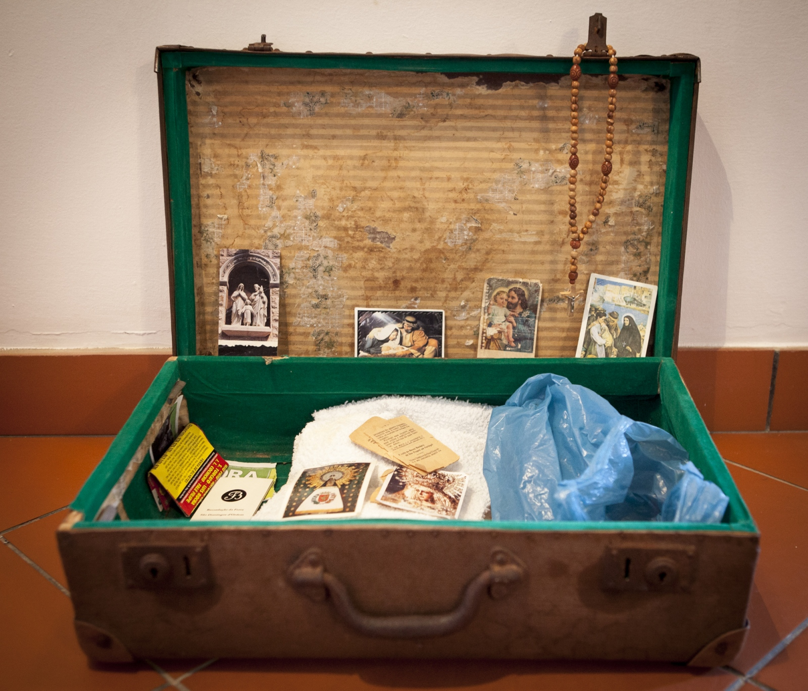 A suitcase belonging to one of the forcados. Forcados are extremely  religious.