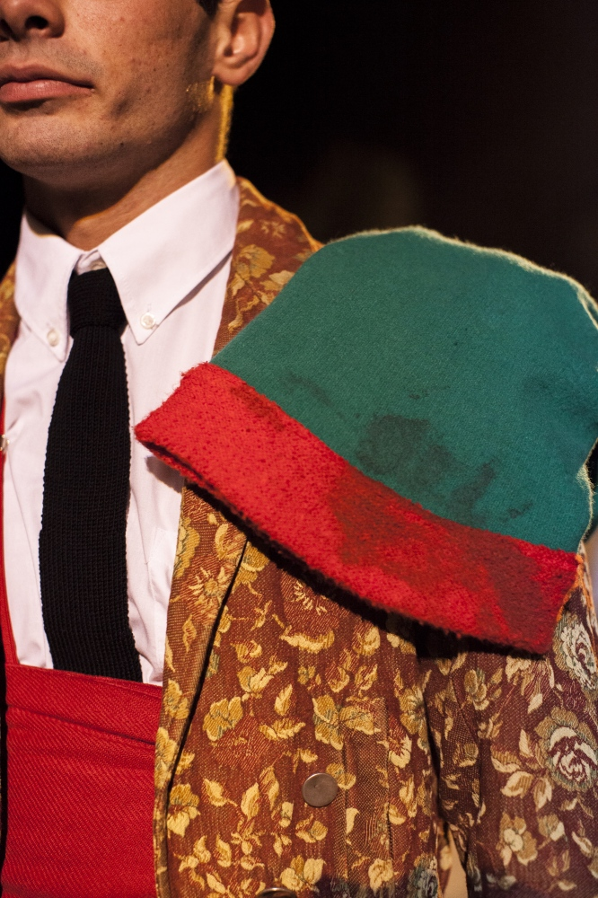 Detail of the forcado's jacket and hat. The hat is never washed, the bloodstains testify the forcados experience.