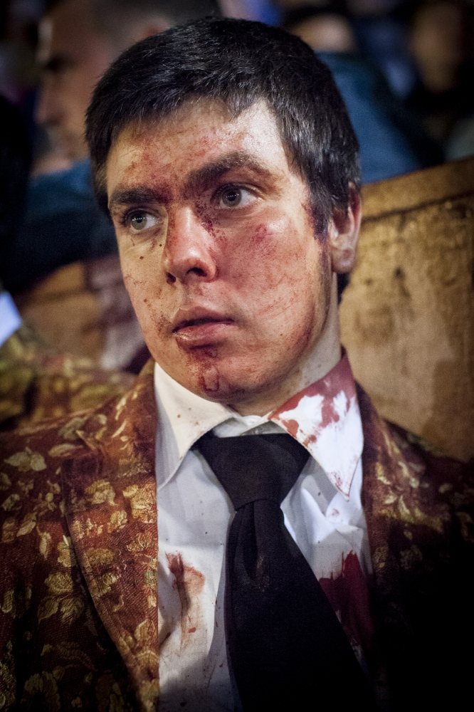 José Martins, member of the Forcados of Évora, is lost in thoughts after a difficult catch of the bull. He was only able to catch the bull after three attempts.
