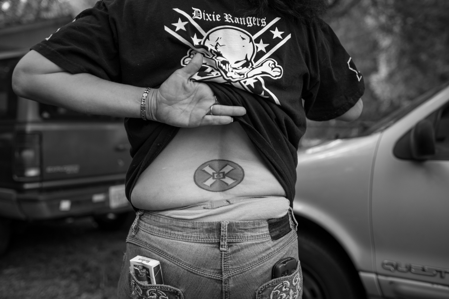 """Baton Rogue, Louisiana.A """"Mioak"""" tattoo displayed at a Klan gathering. """"Mioak"""" stands for: The Mystic Insignia of a Klansman. Today it is most commonly known as the Blood Drop Cross. It is displayed as the patch seen on the robes of Klansmen. It is also a part of the Imperial Seal of the Klan."""