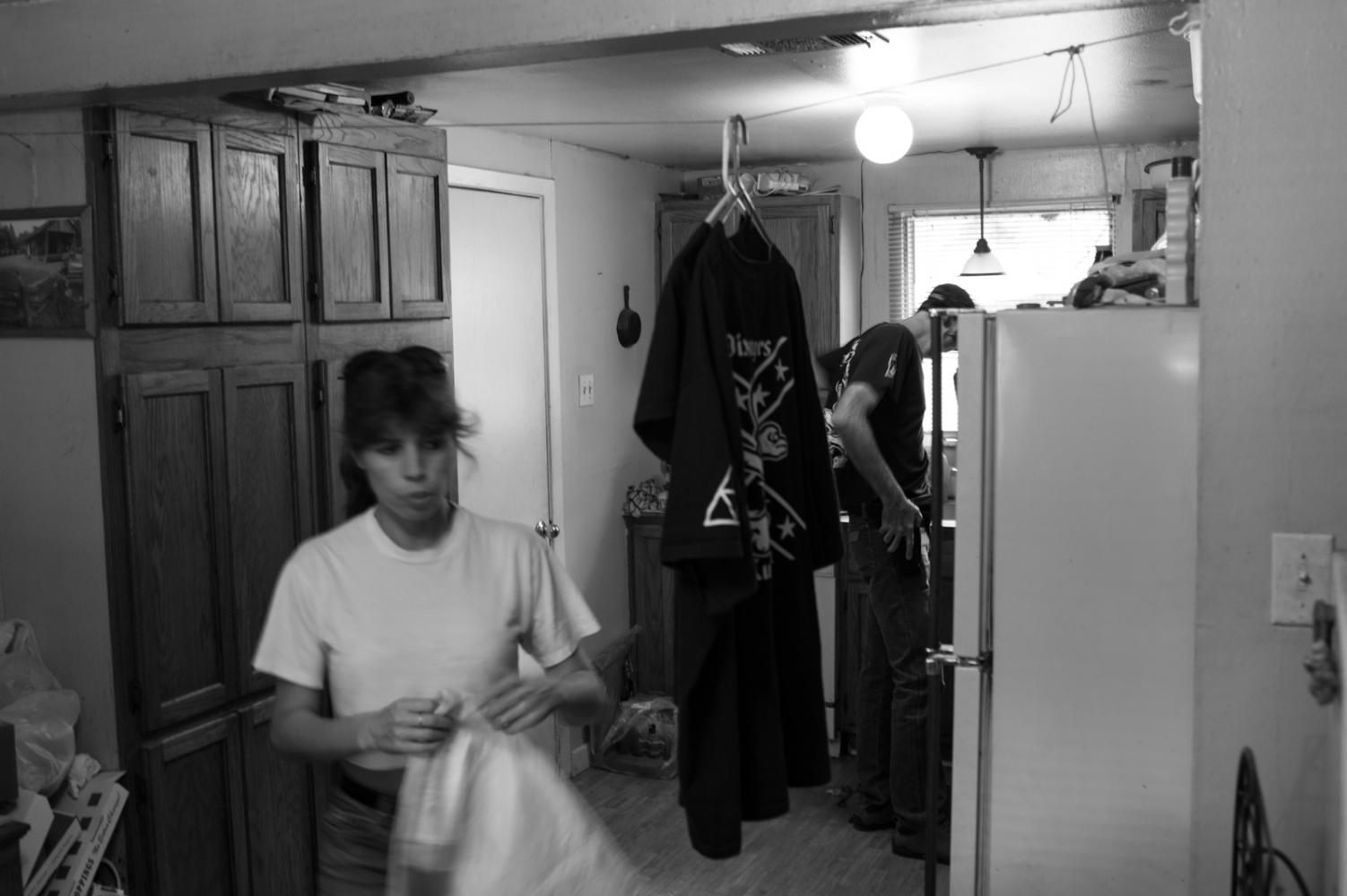 Baton Rogue, Louisiana.Two Klan members prepare for a ceremony.