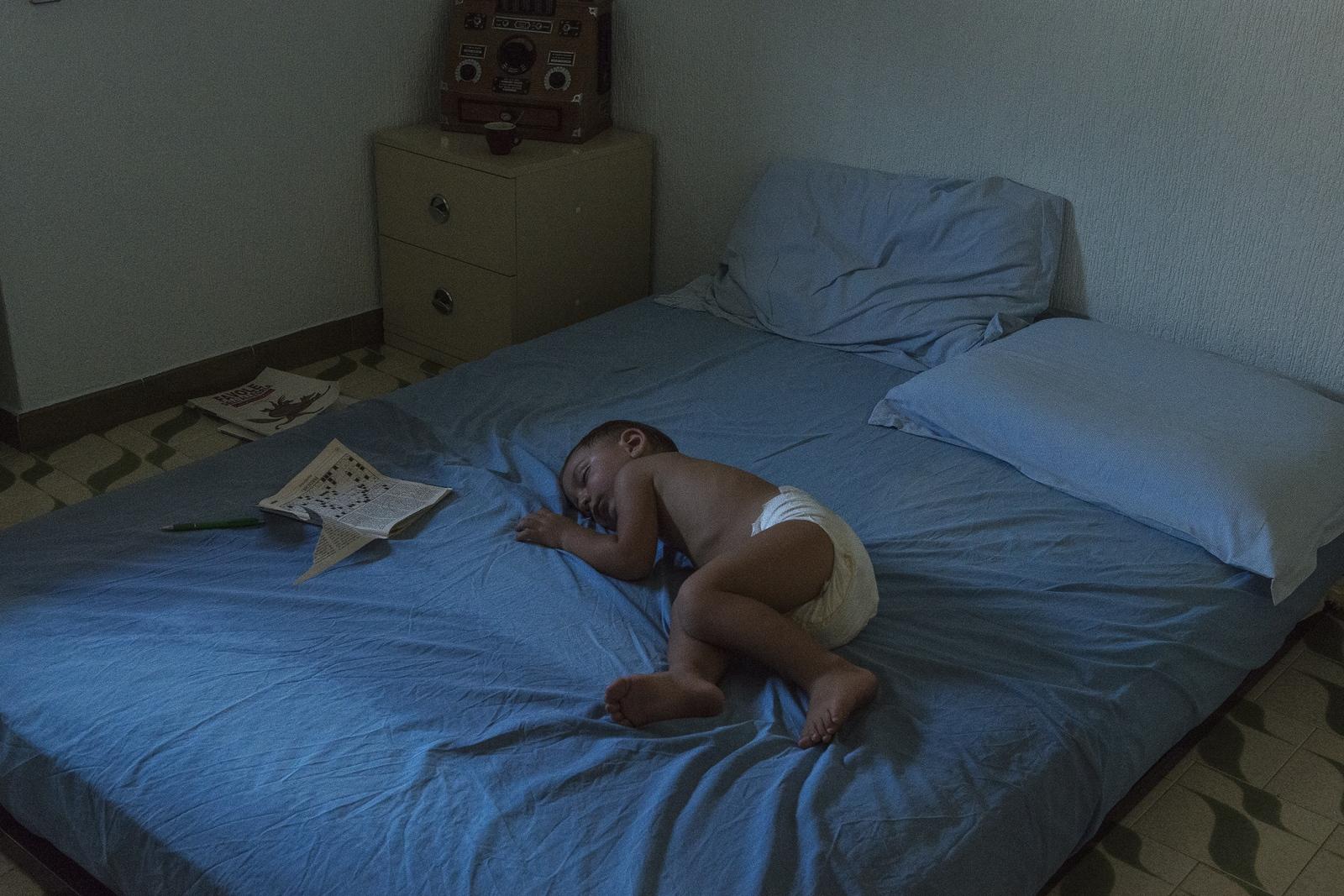 Art and Documentary Photography - Loading 2_their_baby_sleeping.jpg