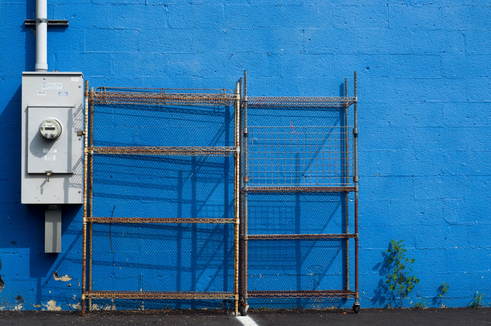 Art and Documentary Photography - Loading metal-racks-blue-wall.jpg