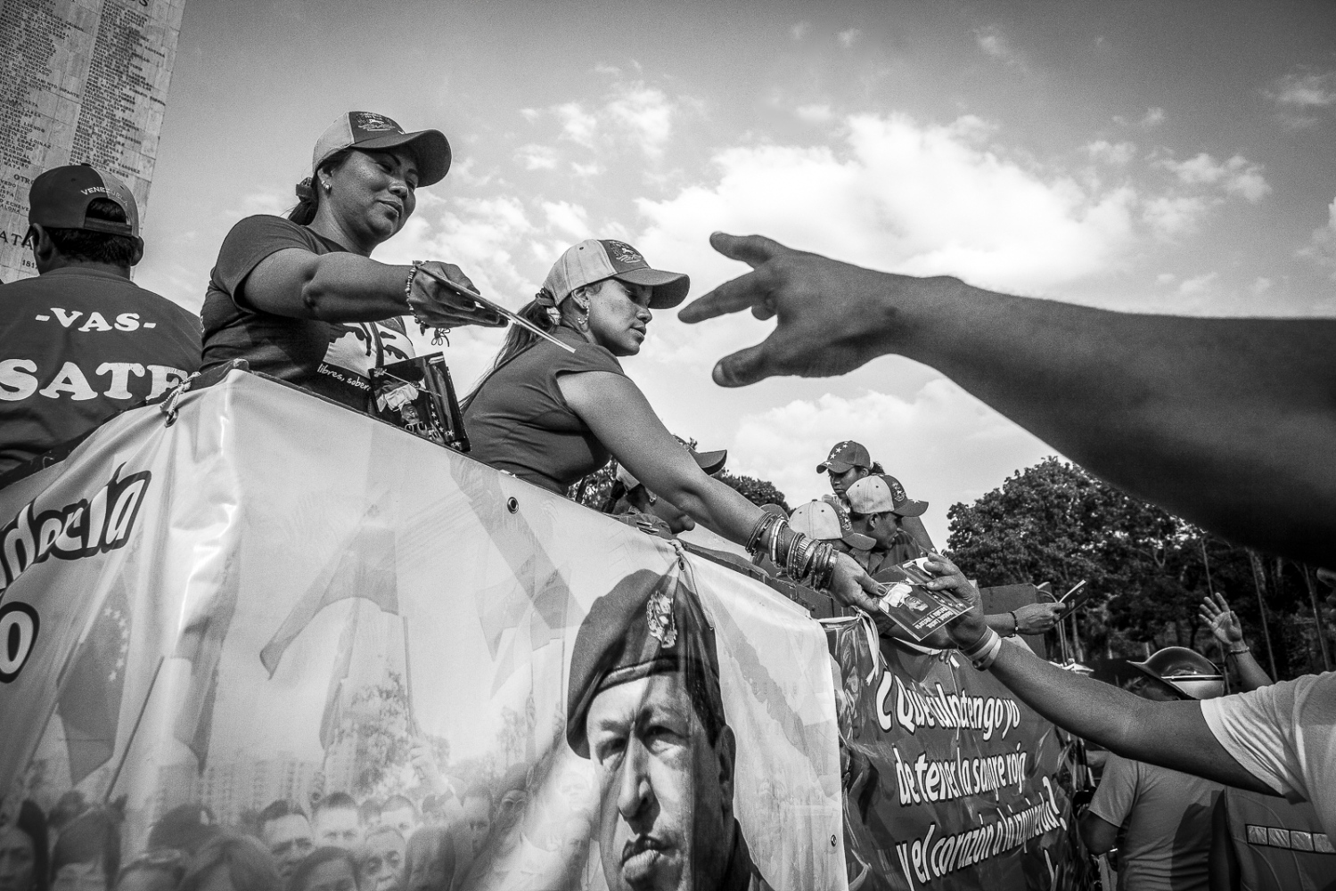 Chávez supporters distribute propaganda during the funeral of Venezuela's President, Hugo Chávez, in Caracas, 8th March 2013. With the death of the President new elections were called to name his sucessor.