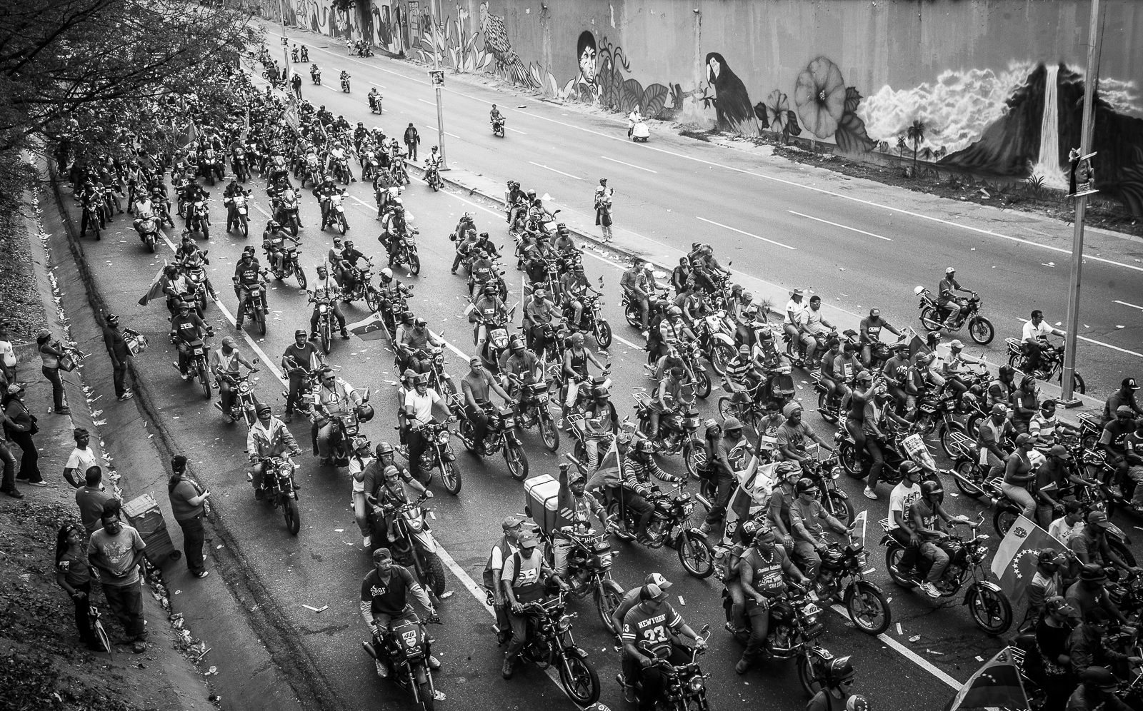 Hundreds of motorbikes chase the official motorcade with Venezuela's President, Hugo Chávez, on a high-way of  Caracas on the 15th March, 2013. The coffin of Venezuela's President, Hugo Chávez, was translated from the Military Academy to the 4th February Military where Chávez remains rest.