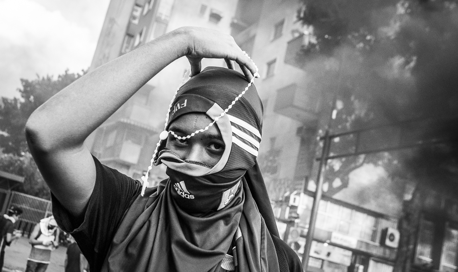 A student holds a rosary during the protests in Altamira, Caracas. The demontrations and confronts started on February 12th, and caused 42 dead, hundreds of injured and 1030 detained during the two month protests against the Government of President Nicolas Maduro.