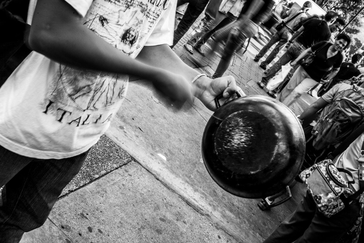 Cacerolazo, a man makes some noise with a cooking pot during a student protest in Altamira 21st March 2014. The demontrations and confronts started on February 4th, cause 42 dead, hundreds of injured and 1030 detained since the movement against the Government of President Nicolas Maduro started.