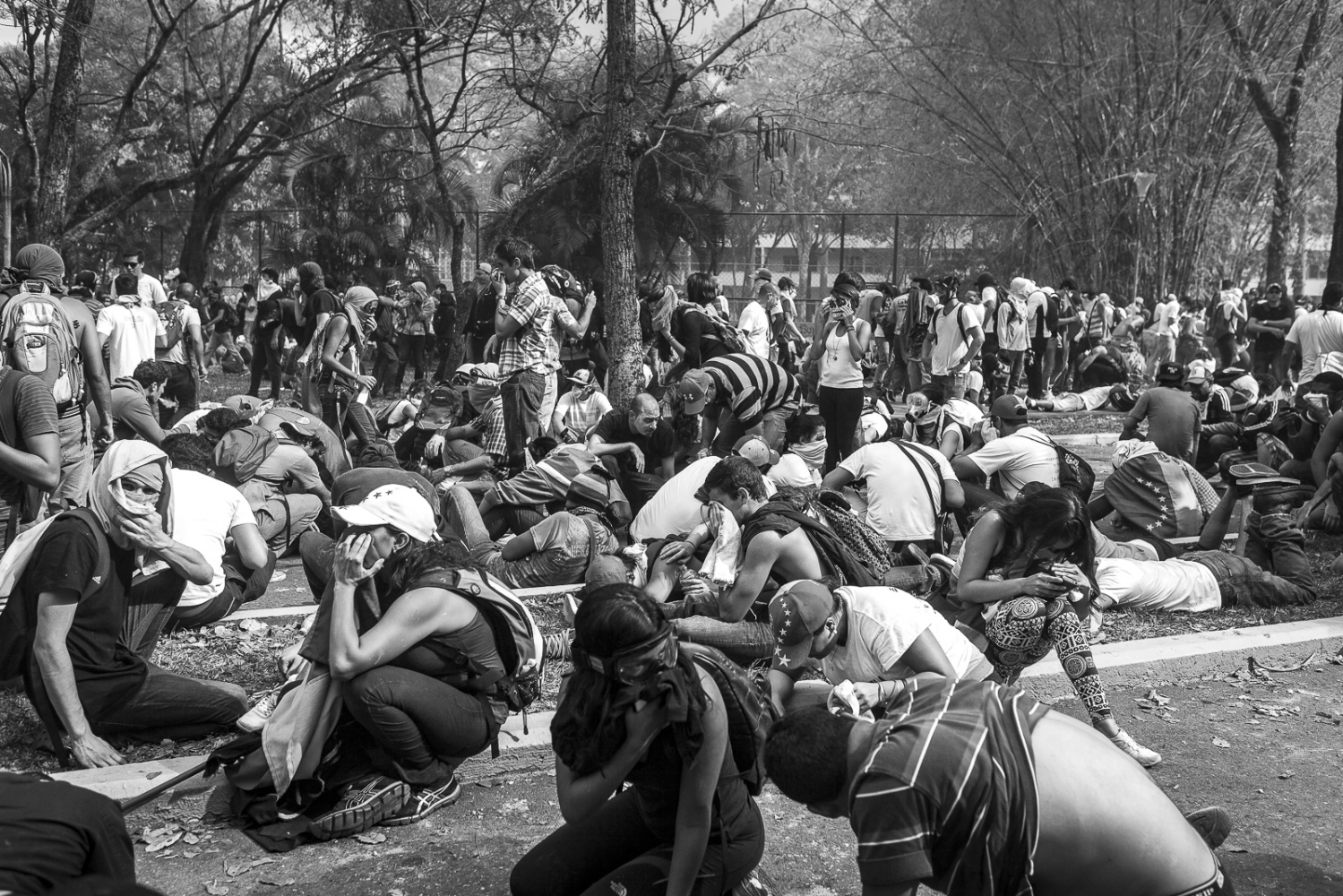 Students try to lay low to protect themselfs from the tear gas during the confronts with the Bolivarian National Police (PNB) in the Central University of Caracas (UCV), 12th March 2014. The demontrations and confronts started on February 12th, and caused 42 dead, hundreds of injured and 1030 detained during the two month protests against the Government of President Nicolas Maduro.